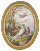 A late 19th Century oval painted porcelain panel depicting grouse/pheasant in woodland