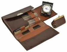 A gentleman's travelling companion set, 20th century in a crocodile style flap-over case, comprising