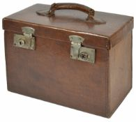 A leather rectangular travelling case, 20th century with leather cover handle and chrome front