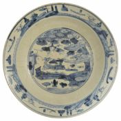 A large Chinese late 17th/18th Century Swatow blue and white pottery charger the centre painted with