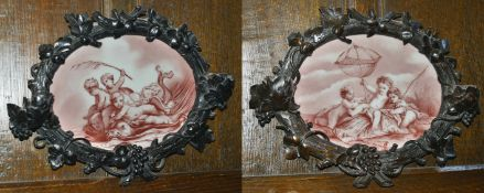 A pair of oak carved and porcelain plaques, late 19th century the first oval porcelain plaque