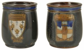Two Royal Doulton pottery Tobacco jars each with a crest on the front, 'Somerville AD 1879' and '