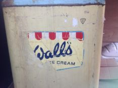 A vintage Walls commercial freezer circa 1960 with rubber twin lids to the top, and Walls transfer
