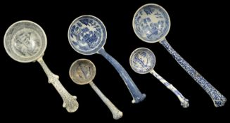 A collection of transfer printed ceramic ladles, 19th century and later four with blue and white