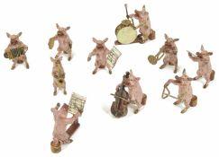 Franz Xaver Bergmann, (Austrian 1861 - 1936) a ten piece cold painted bronze band of pig