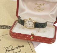 A Cartier Tortue 18ct yellow gold and diamond Ladies wristwatch the champagne dial with roman