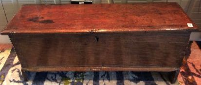 An oak sword chest, late 18th century of rectangular form, with hinged lid, above tapering sides
