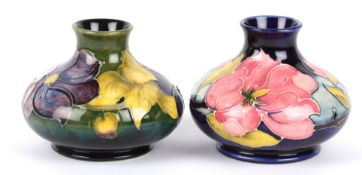 Two William Moorcroft tube lined squat vases, 20th century each decorated with floral sprays of