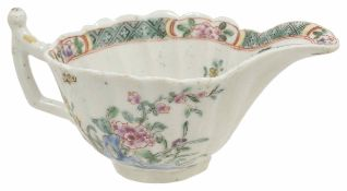 An early Worcester porcelain cream boat, circa 1753 with scalloped edge, the interior has hatched
