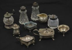 A collection of assorted silver and cut glass cruets comprising pepper grinder with turned wooden