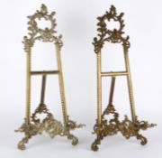 A pair of brass decorative easels, 20th century of typical easel form with pierced and scrolled