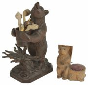 A Black Forest bear pipe rack, 20th century the standing bear holding a removable barrel, raised