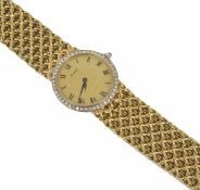 An 18ct gold and diamond ladies Piaget bracelet watch of slim construction, the circular dial within