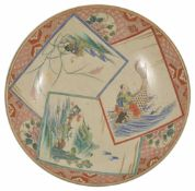 A 19th century Japanese Au Kutani charger painted with a trip of panels depicting a mountainous