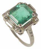 A good high Art Deco emerald and diamond set ring the central rectangular emerald of good colour