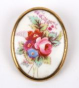 A vintage Royal Worcester porcelain brooch the oval brooch painted with a spray of summer blooms