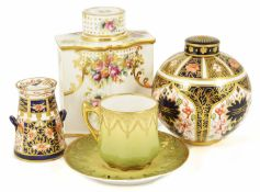 A Royal Crown Derby porcelain milk churn, circa 1913 typical twin handled form in Imari palette,