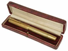 An early 20th century Olo 18kr cased fountain pen, with engine turned decoration to body, level