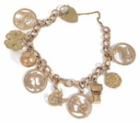 A 9ct gold curb link charm bracelet with heart padlock fastening, hung with a variety of charms