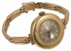 An Art Deco 9ct gold ladies wristwatch on gold bracelet the circular dial within a wide gold mount
