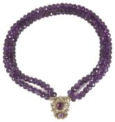 An unusual amethyst bead necklace the two rows of facetted amethyst beads with central amethyst