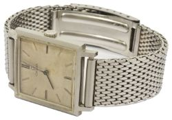 An Omega stainless steel gentleman's wristwatch the square white dial with baton hours with black