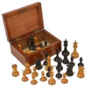 A mahogany cased chess set probably by Jaques Staunton, comprising of 32 pieces, a rook and a knight