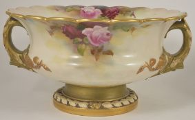 A Royal Worcester twin handled pedestal centre bowl, painted by Reginald Austin, dated 1910 the