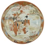A Japanese Kutani charger, early 20th century of circular form with a band of foliage in orange