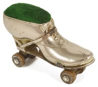 A ladies novelty Edwardian roller skate pin cushion the metal boot with heel and ribbon tie,
