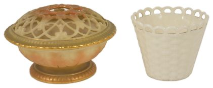 A Belleek porcelain basket, late 19th/early 20th century of conical form with wavy pierced rim above