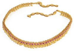 An attractive Indian gold and ruby set choker of fine boteh design fully articulated, the single