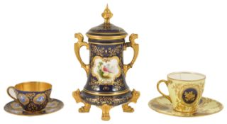 A Coalport twin handled vase with cover, late 19th/early 20th century, the gilt finial above blue