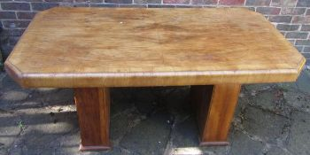 An Art Deco burr walnut dining table, of canted rectangular form with two rectangular sectioned