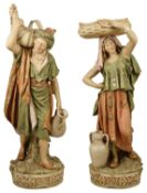 A tall pair of Royal Dux Water Carrier Figurines, late 19th/early 20th century of tall