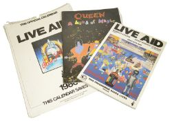Three items of rock ephemera including a Live Aid programme together with an official Live Aid