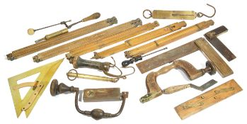 A collection of various carpenters tools, comprising of two set squares, two hand drills, two