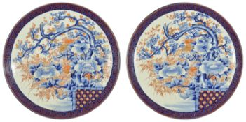A pair of very large Japanese Imari circular chargers, circa 1900 the centre painted with a bird