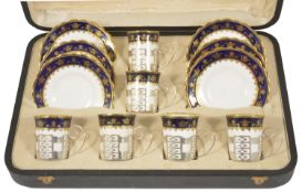 A George V suite of six Aynsley silver mounted coffee cans with saucers, Sheffield 1928 the coffee