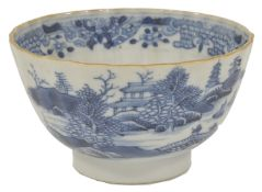 A blue and white porcelain tea bowl, 18th century, possibly Caughley, of circular gadrooned form,