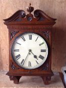 A late 19th century mahogany wall clock with scrolled mahogany pediment the painted dial with