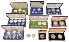 A collection of Franklin Mint and Royal Mint Coinage to include a cased set of 9 1976 Jamaica