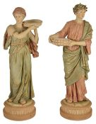 Two Royal Dux figurines, late 19th/early 20th century modelled as a female holding a circular dish