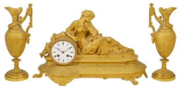A French gilt metal garniture circa 1870 the bell striking Japy Freres movement, with enamel dial,