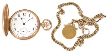 A 9ct gold Waltham USA full hunter pocket watch the white dial with Arabic numeral hours, baton