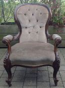 A Victorian mahogany button back upholstered armchair with scrolled front supports height: 92 cm,