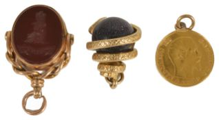 A Victorian gold mounted carnelian and bloodstone swivel fob with carved armorial, together with a