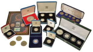 A collection of British Coinage to include a cased set of four £1 silver proof coins, a cased 25th