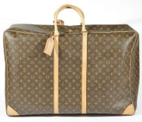 A Louis Vuitton Sirius 45 monogrammed canvas travel suitcase/bag, monogrammed canvas with tan