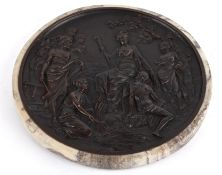 A decorative circular plaque, 20th century with composite surrounding the resin central disc,